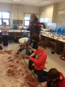 FWA principal Kiki Abrahamson works with strudents
