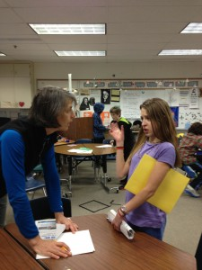 Catie Bursch from Isalnds and Oceans works with Brita Restad as she prepares for the student -led discovery lab