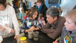 Coda explains his demonstration to FWA parent Mary Jo during the Oil Spill Discovery Lab 2014 038